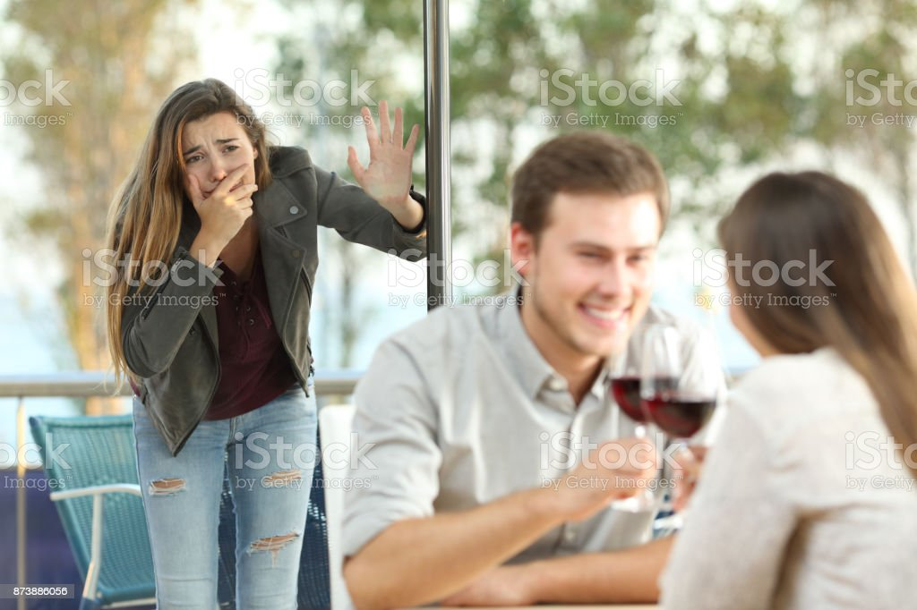 Cheater caught by his sad girlfriend stock photo
