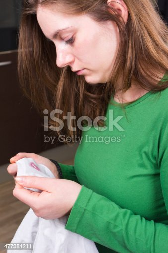 185866319istockphoto Cheating proof: lipstic marks on husband's t-shirt 477384211