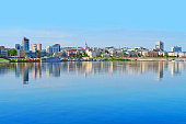 Cheboksary panoramic cityscape. Embankment, Cheboksary bay. View of the downtown city from the Volga river, reflection of the city in the water
