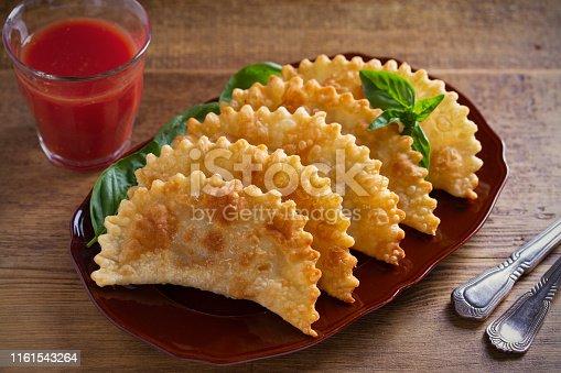 Chebureki - pan fried pies with meat and onions on plate. Fried-dough food. Horizontal - image