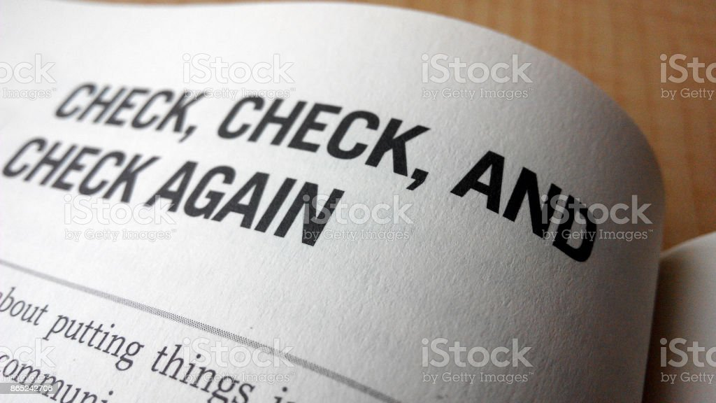Check again word on a book stock photo