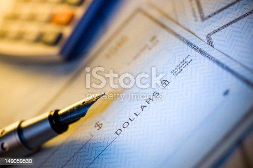 Money check,pen and calculator