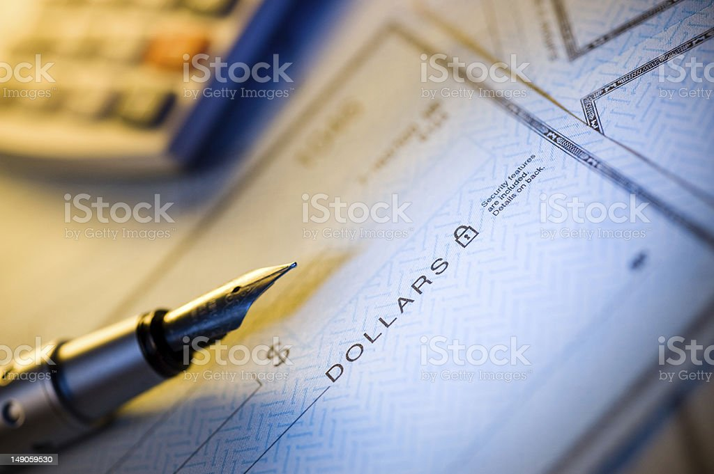 Check and pen stock photo