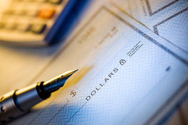 check and pen - blank check stock photos and pictures
