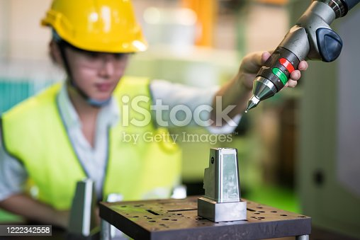 1142508104 istock photo check automation robot arm in factory 1222342558