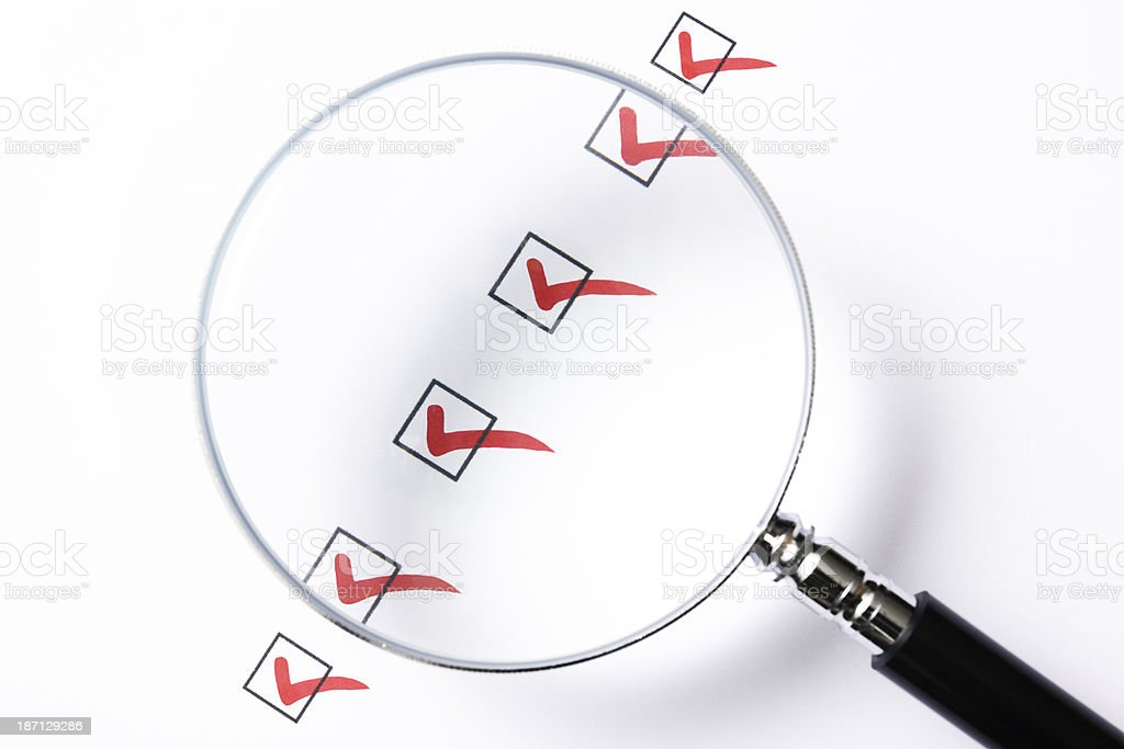 Check box with magnifying glass on white background stock photo