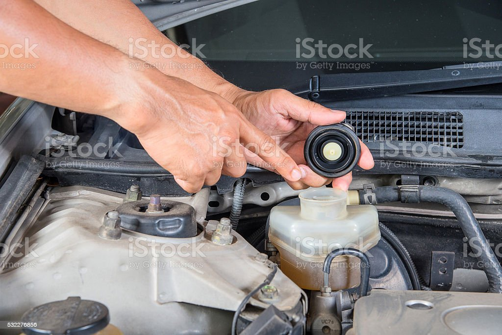 Check brake fluid inlet,Car maintenance,Check  car yourself. stock photo