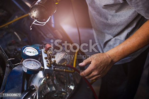 istock Check car air conditioning system refrigerant recharge 1134008672