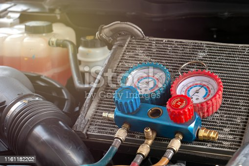 962280084 istock photo Check car air conditioning system refrigerant recharge 1161182202