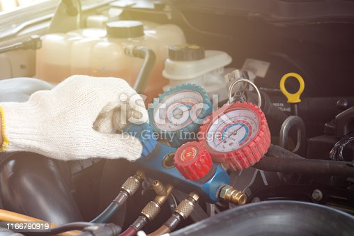962280084 istock photo Check car air conditioning system refrigerant recharge 1166790919