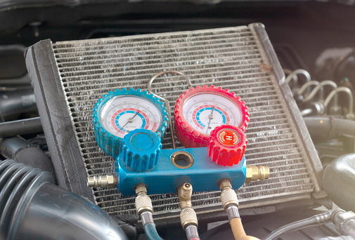 istock Check car air conditioning system refrigerant recharge 1168556251