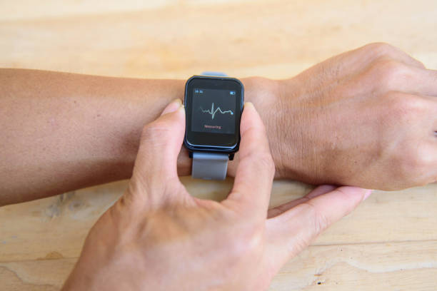 Check ECG by smartwatch / Check Heart rate by Smartwatch stock photo