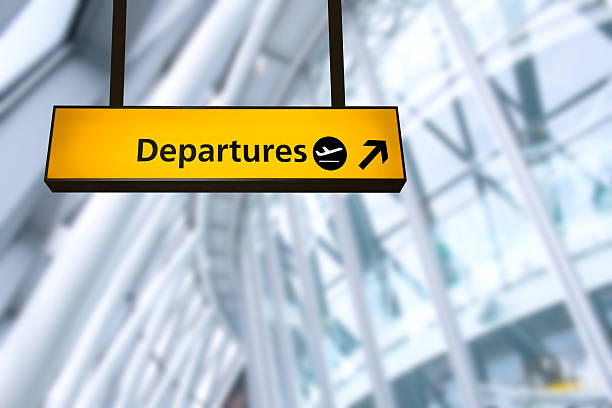 check in, airport departure & arrival information board sign - arrival stock photos and pictures