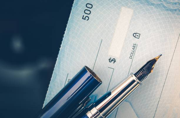 check issuing concept - blank check stock photos and pictures