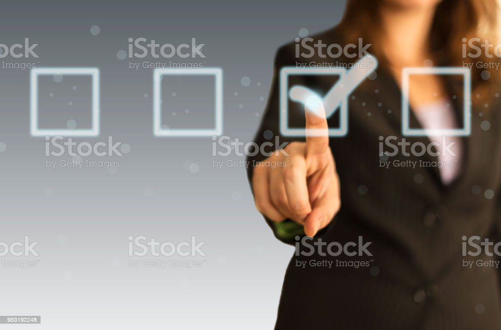 Check mark on touching screen stock photo