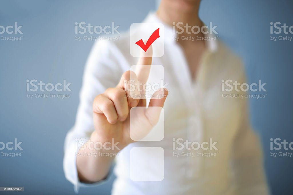 Check mark Businesswoman pushing button on touch screen. Accessibility Stock Photo