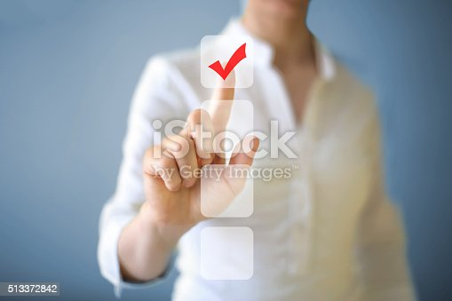 Businesswoman pushing button on touch screen.