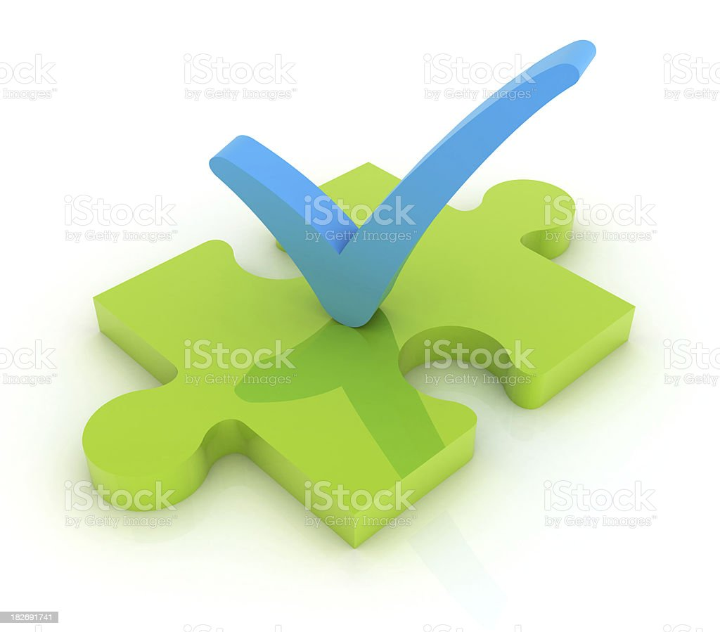 Check mark with puzzle royalty-free stock photo
