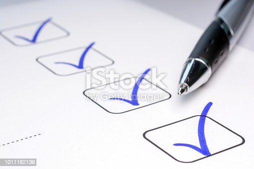 istock Check off completed tasks on a to-do list 1011182136
