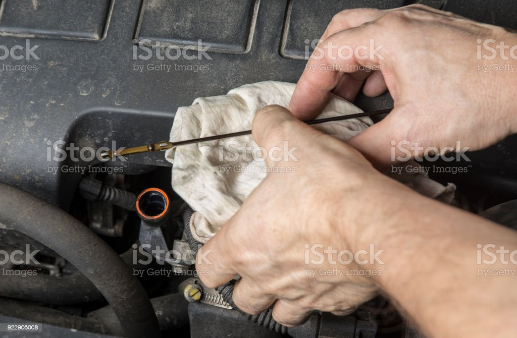 Check Oil Level At Dipstick Mark In Car Engine Stock Photo