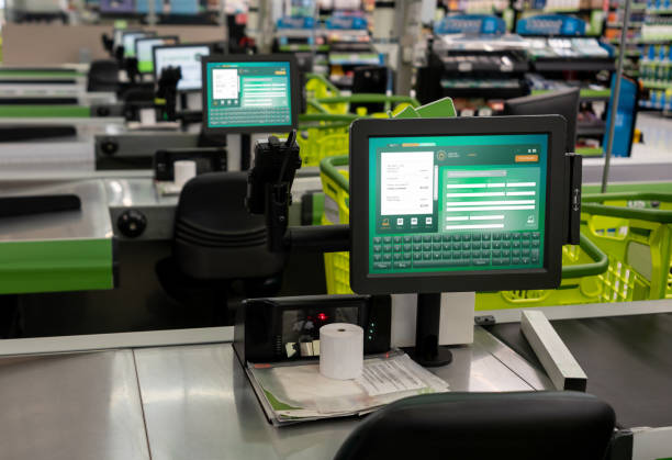 Check out terminal in supermarket - No people Check out terminal in supermarket - No people cash register stock pictures, royalty-free photos & images