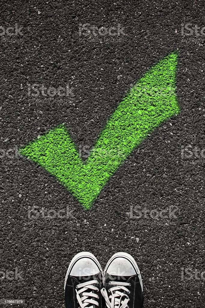 Check sign and shoe royalty-free stock photo