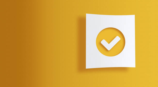 check sign on white information paper on yellow background stock photo