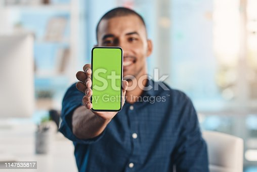 Cropped portrait of a handsome young businessman showing you a monochrome display on his mobile phone