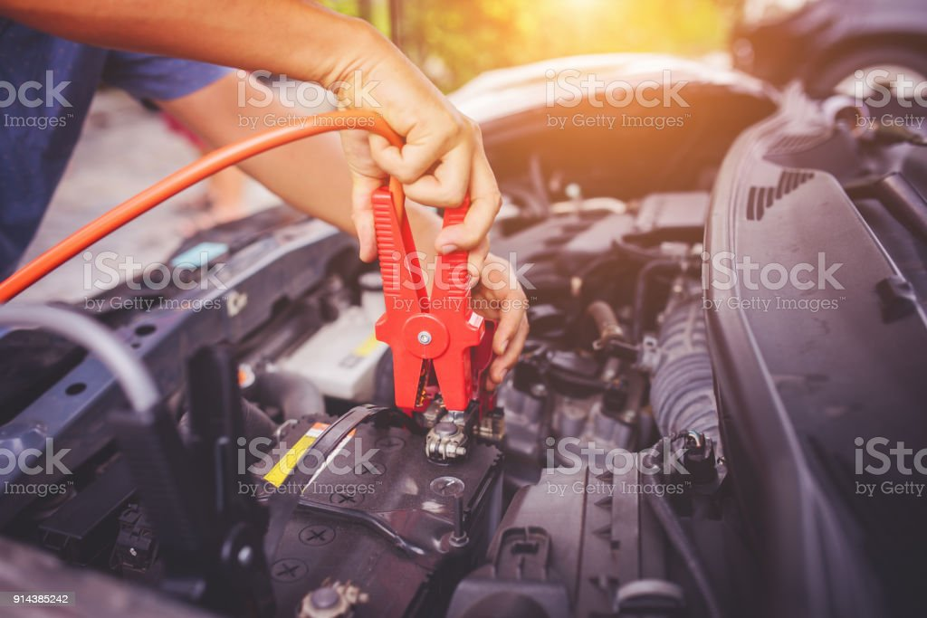 Check voltage level car battery. stock photo