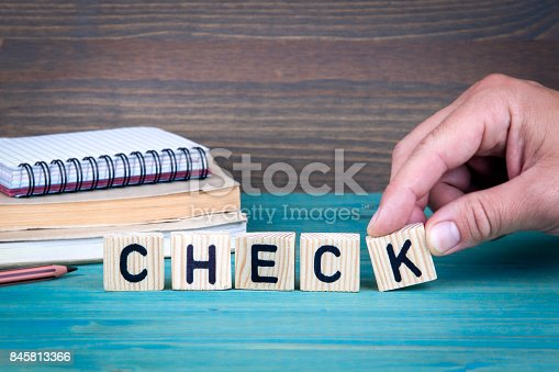 istock Check. Wooden letters 845813366