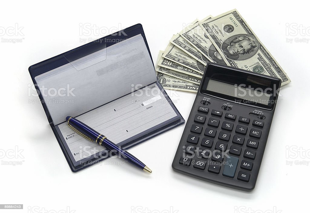 A checkbook, cash, and calculator stock photo