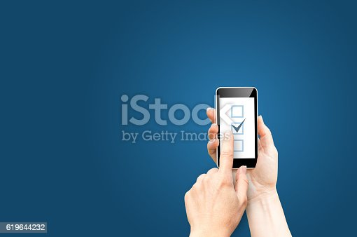 istock Checkboxes on phone screen 619644232