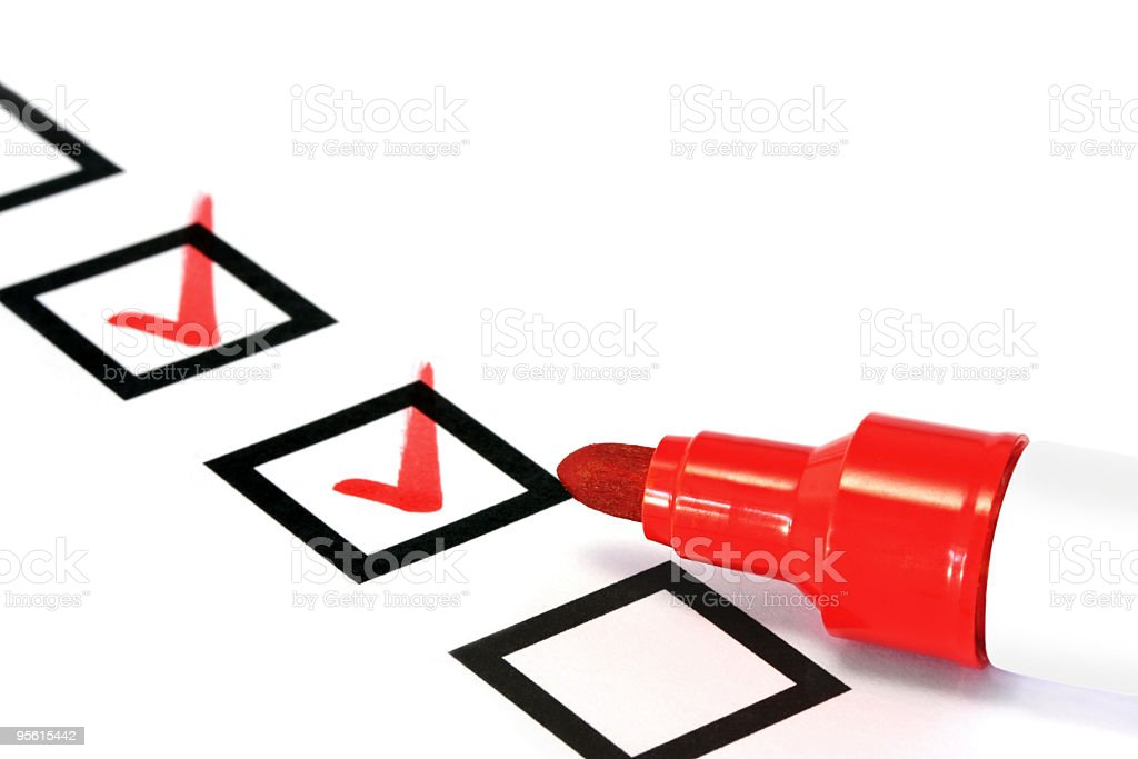 Checkboxes with red check marks and a red marker stock photo