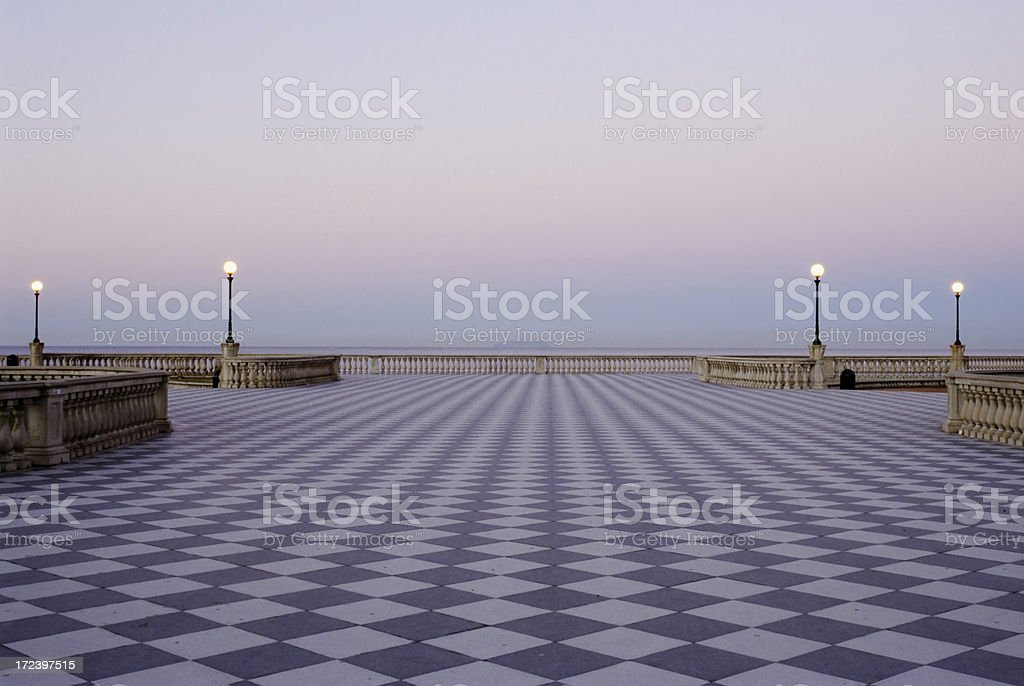 Checked Boardwalk by the Sea at Dawn royalty-free stock photo