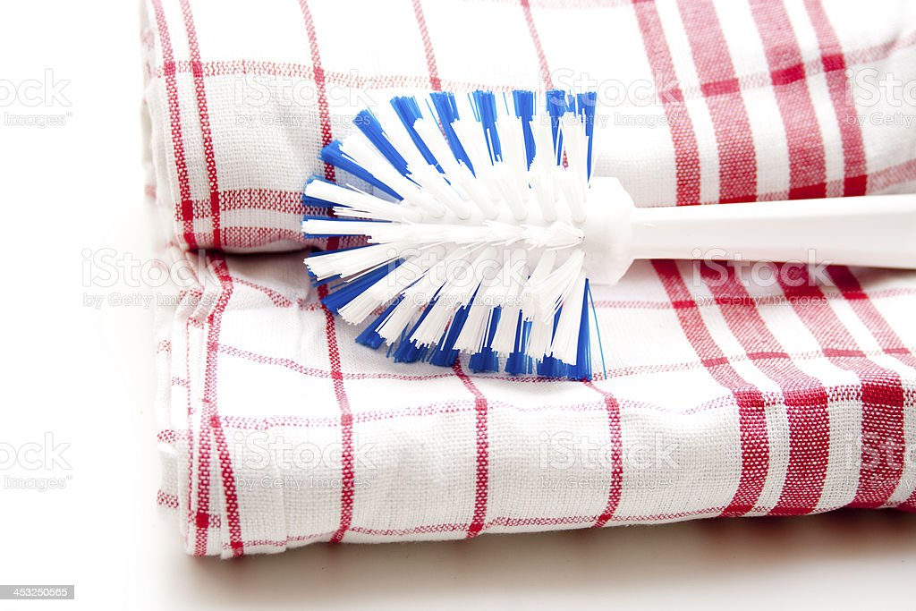 Checked dish towels with rinsing brush royalty-free stock photo