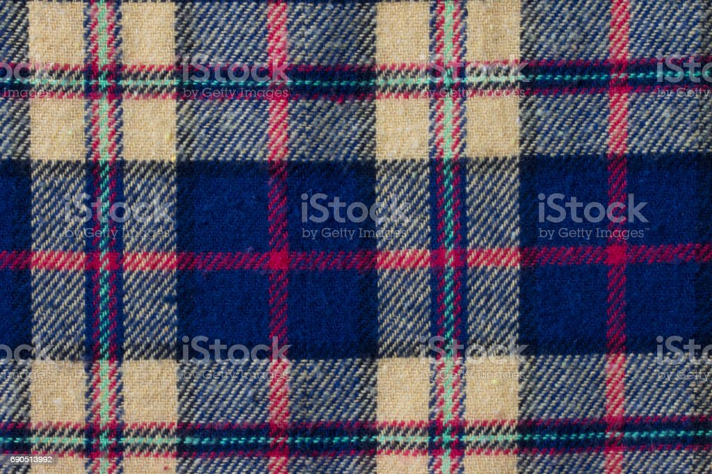 checked pattern fabric, gingham pattern in red, yellow and navy blue yarn.background stock photo