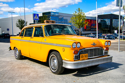 Moscow, Russia - September 1, 2016: Yellow Checker taxi of New York is parked in the city street.