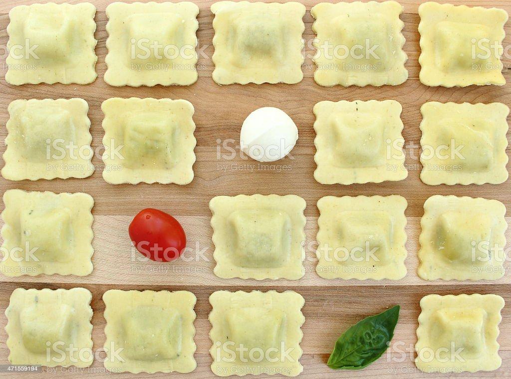Checkerboard ravioli with tomato, bocconcini and basil stock photo