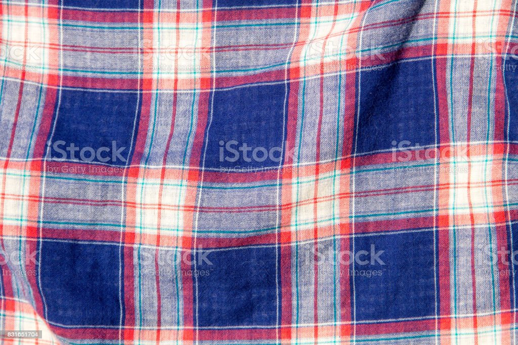 Checkered fabric plaid  texture. Traditional Scottish pattern. Cloth background stock photo