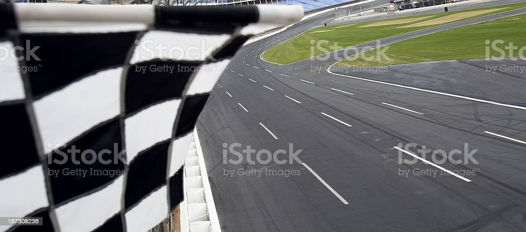Checkered flag and motor speedway stock photo