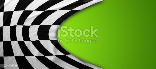 istock Checkered flag on green 1224408788