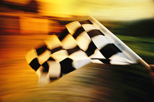 Checkered flag waving at an car race. stock photo