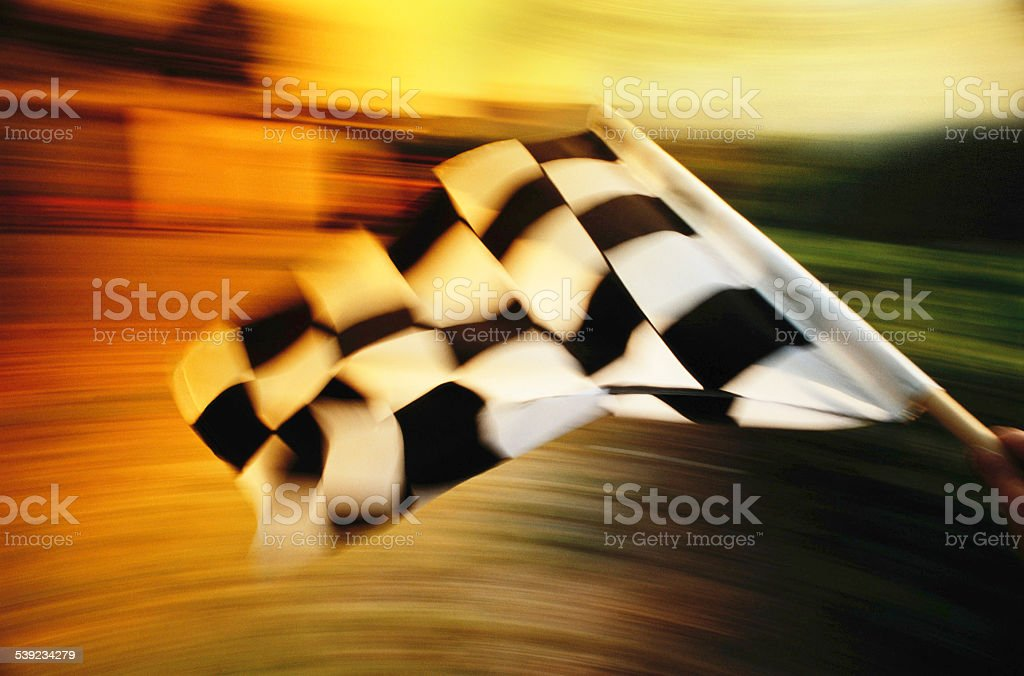 Checkered flag waving at an car race. stock photo