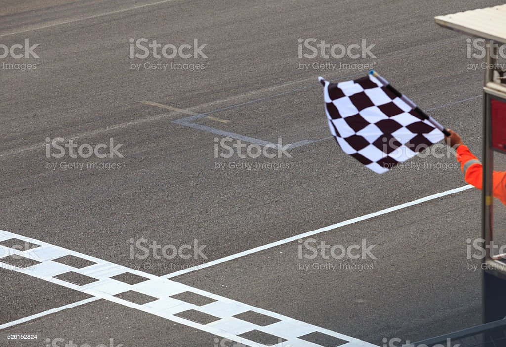 Checkered flag waving stock photo