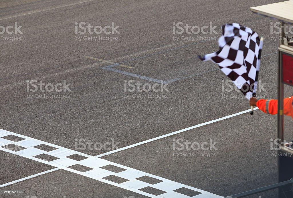 Checkered flag waving stock photo