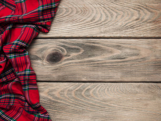 Checkered napkin on a wooden background Checkered napkin on a old brown wooden  background plaid stock pictures, royalty-free photos & images