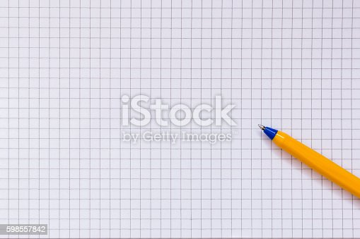 istock Checkered paper and pen 598557842