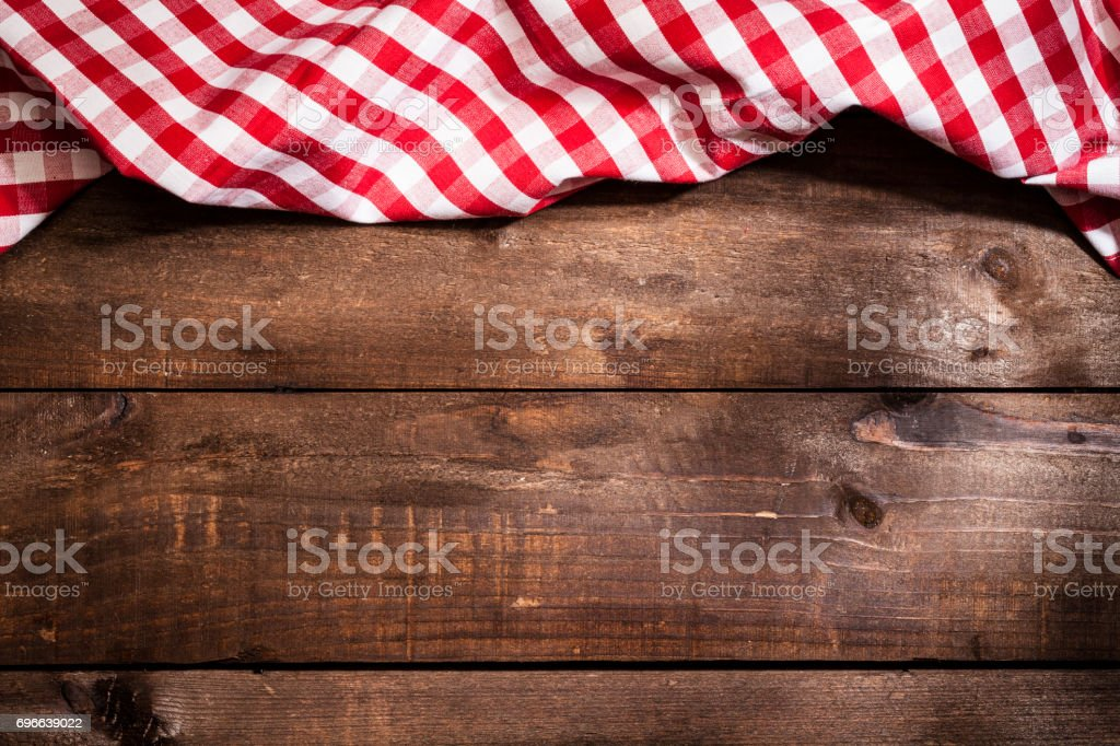 Checkered tablecloth on rustic wooden table stock photo