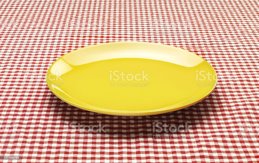 Checkered Tablecloth with Plate royalty-free stock photo