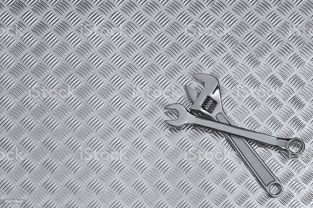 Checkerplate and wrenches background stock photo
